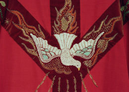 a red chasuble with dove detail